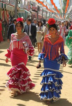 "Feria de Sevilla 2012. These women have the ""flower on top of the head"" look which became popular a few years ago."