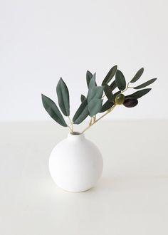 Elevate any living space with faux greenery and artificial plants that look real! Style in your favorite vase or plant in a terracotta pot. Enjoy the beauty of plants without the maintenance. Shop trending faux greenery and artificial plants at Afloral.com. Fake Plants, Artificial Plants, Hanging Plants, Nandina Plant, Vase With Branches, Faux Olive Tree, Greenery Garland, Branch Decor, Flower Branch