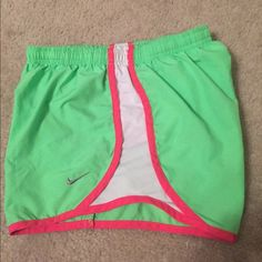 Girls Youth L Nike Shorts. Lime green and pink. Like new no stains or tears. Super cute I've just put grown them. These could probably fit a women's XS as well. Any questions just ask. Cheaper on Merc Nike Shorts