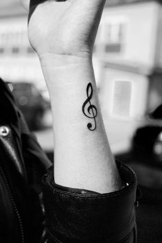 Treble clef tattoo- Simple, but it really speaks to me as a singer and general music lover. Maybe on one of my shoulders instead? With a heart and cross. Cant figure how it will all work together. Maybe the cross with the heart in the middle. And the bottom looking like a treb cref... Need a good artist..