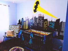 Batman nursery, baby boy nursery inspiration. Batman crib bedding, Gotham City vinyl decal.