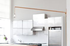 DIY Idea - Wall mounted hanging light.  Good for areas that overhead lighting but don't have the ceiling socket. This one is by Chuck Routhier on supermarkethq.com