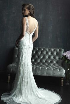 Incredibly beautiful, beaded, overlay, wedding dress with straps from Allure Bridal. Back view.