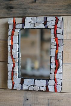 We call this small mosaic wall mirror Mother Lode. Our mosaic artist Johannah combined reclaimed concrete and Mexican smalti, a richly colored