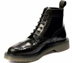 According to the statement they were Doc Marten's, but this was quickly question by keen-eyed fans who were more taken with the Loakes Black Smooth Leather Brogue Boot.
