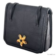 "Judith Leiber karung black handbag, starfish plaque and semi precious stones, lyard, American, circa 1980s. Width: 7-1/2"" Height: 7""  The MAAC Holiday Collection  http://the-maac.com/treasures-pleasures?id=67&tid=3232"