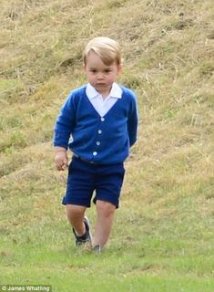 George, who is becoming a fashion icon in his own right was dressed in an £64 Olivier card...
