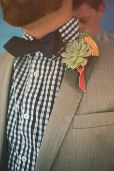 checkered shirt, bow tie, and succulent boutonniere, photo by Hello Miss Lovely http://ruffledblog.com/western-florida-beach-wedding #boutonnieres #succulents #groom