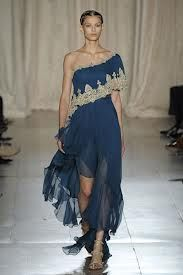 7. b) Marchesa gown inspired by Ancient Roman attire.