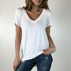 "• Reserved• Perfect White Tee L Superb quality tee. Look no further for that perfect cut & fit. Fabric is silky smooth & drapes on the body beautifully. V Neckline. Size M measures 94% Viscose 6% Spandex. For size reference I am wearing Size S- 5'3""-105lbs -Sz 0/2 * Please do not purchase this listing- Thank you! * Boutique Tops Tees - Short Sleeve"