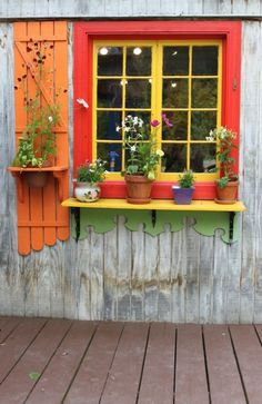 painted window shelf...flowers  Would love  to have a little cottage in the keys  with a window box and house using these color. Would be one of my dreams come true .  Just live the simple life 'm