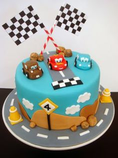 Cars Cake or spiderman depends on if he's still crazy about them for his 3rd bday!