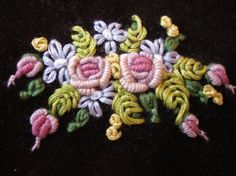 Bullion rose spray ... this looks like it was done in wool threads but I think silk or even cotton would also be lovely.