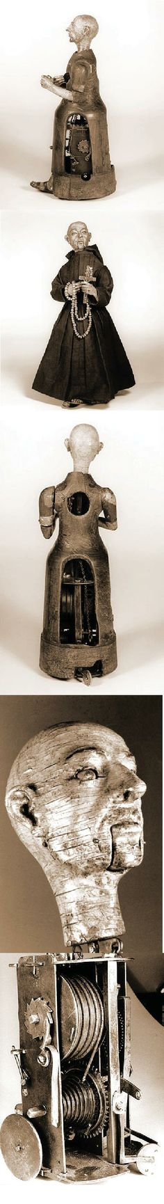 """An automaton of a monk, 15 inches in height. Driven by a key-wound spring, the monk walks in a square, striking his chest with his right arm, raising and lowering a small wooden cross and rosary in his left hand, turning and nodding his head, rolling his eyes, and mouthing silent obsequies. From time to time, he brings the cross to his lips and kisses it. After over 400 years, he remains in good working order."