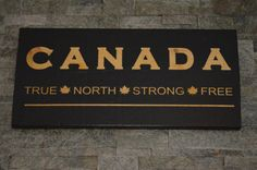 Canada Wood Sign. Canada True North Strong Free.  Celebrate Canada 150 Years!!! Show your patriotism. Perfect for your home or cottage. Lets celebrate the great country of Canada!  This sign is approx 12 x 24 x 1 thick. Made from solid rough sawn pine, painted with a black background, and white painted lettering. The sign comes with two hooks on the back for sturdy hanging. Our signs are finished with an indoor sealant.   All of our products are 100% Canadian Made by us!  Please note that…