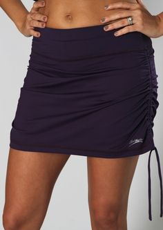 """Semi-fitted  Flat elastic waistband  Internal self-fabric fitted shorts  Adjustable ruching on sides of skirt  """"StayDry"""" Wicking Microfiber Material  UV Protection UPF 50 - Blocks 98% of sun's UV rays  Anti-Bacterial Treatment  Skort length: Adjustable           $70.00      Product Code: 201107"""