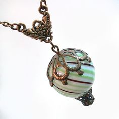((Etsy Store. Makes tones of Balloon Necklaces and Bullet Earrings))  Hot Air Balloon Pendant Necklace Jewelry by TrashAndTrinkets, $32.00
