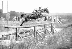 """The winner of the silver medal at the 1936 Berlin Olympics, Captain Thomson (U.S.A.) on """"Jenny Camp"""", takes the 35th obstacle during the cross-country competition. Out of 50 entries, 27 horses completed the course, three were fatally injured, and two horses were unable to finish on account of lameness. [fotosochi.ru]"""