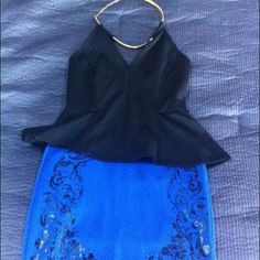 Be2be black and blue peplum dress xs Bebe brand b2b black and blue floral pattern halter neck dress. Fits well. Skirt portion falls above knee. Worn once for a wedding. Questions? Please ask! bebe Dresses Mini