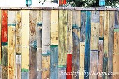 Variety of colors and textures in the DIY fence made from pallet wood, from BeautifulbyDesign.co
