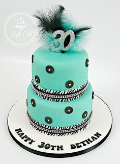 turquoise 2 tier zebra,crystal, feathers,bling birthday cake. #birthday #cake #2tier #feathers #crystals #bling #zebra