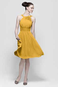 yellow bridesmaids dress...I like everything but the floral neckline.