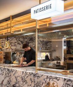tom dixon's le drugstore brasserie encapsulates sixties glamor in paris