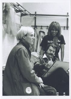 Andy Warhol, LeRoy Neiman and Tina Turner at a Rolling Stones concert. Photographer unknown.