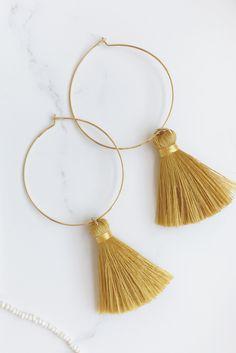 Gold tassel hoop earrings by Le AMICHE Studio