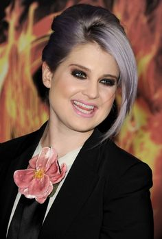 Goth glam punk rock babe look. Heavy kohl eyes and pale lips with fair skin and lilac hair. Awesome for spring.