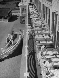 Nurses Tending to Afflicted Children as They Lie on a Sundeck in Sanitarium in Resort