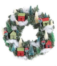 In one word, ADORABLE! Hang this fun Christmas Glitter Village Wreath on your country washed cupboard, inside door or hutch. Street lamp post adorns the wrap around village glitter homes. Embellished
