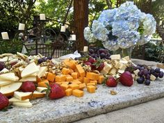 Casually rustic display of food and drink for an outdoor wedding on 30A.