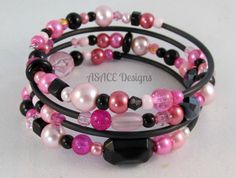 Unique Black and Pink Memory Wire Bracelet - One size fits all (Made using 60mm Memory Wire - adults)    No piece is ever the same. Completely unique each time it is made so you can buy in confidence knowing that no-one will own the exact same piece as you.    Beads used will vary depending on current stock levels so not all beads shown will appear in your bracelet. If you can see a specific bead you would like in your bracelet, please let me know when ordering and I will do my best to…