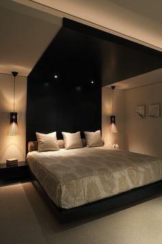 Dark wood accent wall breaks up the symmetry.