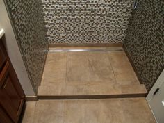 Large Format Tiles With Matte Finishes Can Be Used In Single Slope Shower  Areas (sloped To A Linear Or Channel Drain ) . The Photo Shows Tiles  Sloping To A ...