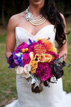 Fuchsia, orange, bright blue, yellow and black wedding bouquet. BOLD and beautiful :)