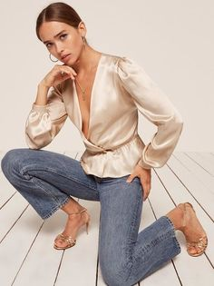 Smooth operator. This is a deep v top with an elastic waistband and two non-functional buttons at the waist.