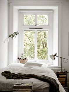 Super white bedroom with a couple of colour accents and a beautiful view of greenery out the window.  #thegoodsheet
