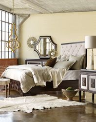 Elegant but young and fresh, the Albion Tufted Bed stands out with its tufted cream-colored headboard bordered in cherry wood and complemented by a cherry footboard in swirl design.