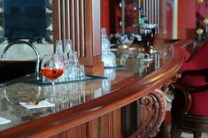 Looking for home bar ideas? This authentic cherry basement pub features a granite bar top, custom moldings, and carved corbels. Cherry Bars, Pub Design, Bar Games, Amish Country, Custom Cabinets, Basement, Table Settings, Game Rooms, Moldings