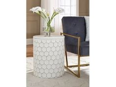Trendsetting and contemporary. Take a fashion risk with this accent stool. Outlined honeycomb design on hammered metal is teeming with texture. Decor on the solid top completes the look with style. 60s Furniture, White Furniture, Cheap Furniture, Furniture Stores, Outdoor Stools, Indoor Outdoor, White Stool, Living Spaces, Living Room