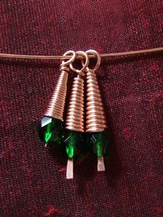 Dangles made with cone coil beads in three gauges. From left to right: 24 gauge, 20 gauge, and 18 gauge.