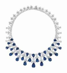 A SAPPHIRE AND DIAMOND NECKLACE, BY GRAFF. The front suspending a graduated three-row fringe of pear-shaped sapphires, enhanced with marquise and circular-cut diamonds, to the variously-cut diamond backchain, mounted in platinum.