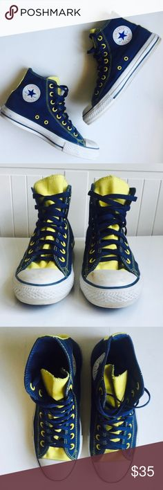 Converse high top navy and yellow size 6.5M/ 8.5W Shoes are slightly dirty. There are some scuffs and marks at toe. Navy outer and inner wall and racing stripe. Yellow tongue, eyelets, stitching, and heel stripe. Flat navy shoelace. Classic white toe cap and toe bumper. Iron on Converse logo on inner ankle. Converse Shoes Sneakers