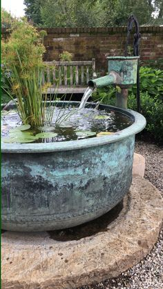 Custom Copper Water Feature - Custom Copper Water Feature A custom design built by Rett, the owner of The Garden Vault featuring a large millstone base, copper cheese vat and copper fountain head set in a millstone base. Diy Water Feature, Backyard Water Feature, Ponds Backyard, Garden Ponds, Backyard Waterfalls, Koi Ponds, Wine Barrel Water Feature, Water Falls Garden, Japanese Water Feature