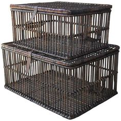 Charming pair of pigeon crate style storage baskets constructed from willow and rattan. Features hinged lids and leather handles. Smaller crate can store inside larger one. These make great coffee tables with a piece of glass on top. Dimensions: 30w x 22.5d x 15h Circa: 20th Century