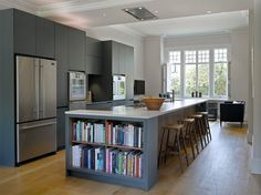 20 Beautiful Kitchens Moms Would Love! Roundhouse Urbo matt lacquer bespoke kitchen with built-in book storage Home Decor Kitchen, Kitchen Living, Kitchen Interior, New Kitchen, Kitchen Furniture, Kitchen Ideas, Space Kitchen, Kitchen Themes, Kitchen Chairs