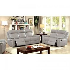 Relax in style with this updated sofa collection. The smooth leatherette upholstery features a gorgeous neutral gray coloring while contrasting welt trim in white emphasizes the sleek lines. Bucket cushions gently curve and support, providing a stylish seating design for the reclining seats.