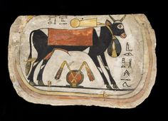Foot-board in painted wood from a cartonnage mummy-case, depicting an Apis bull wearing a heavy menat-necklace, with a shen adorned with a pair of flails below its belly. Thebes, mid Third Intermediate Period, 22nd Dynasty, ca. 940 - 716 B.C.